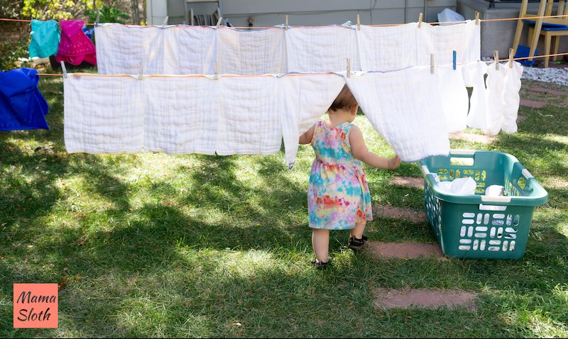 After washing cloth diapers, try drying them on the line. Here's a mama sloth picture of diaper laundry hanging outside. So cute!